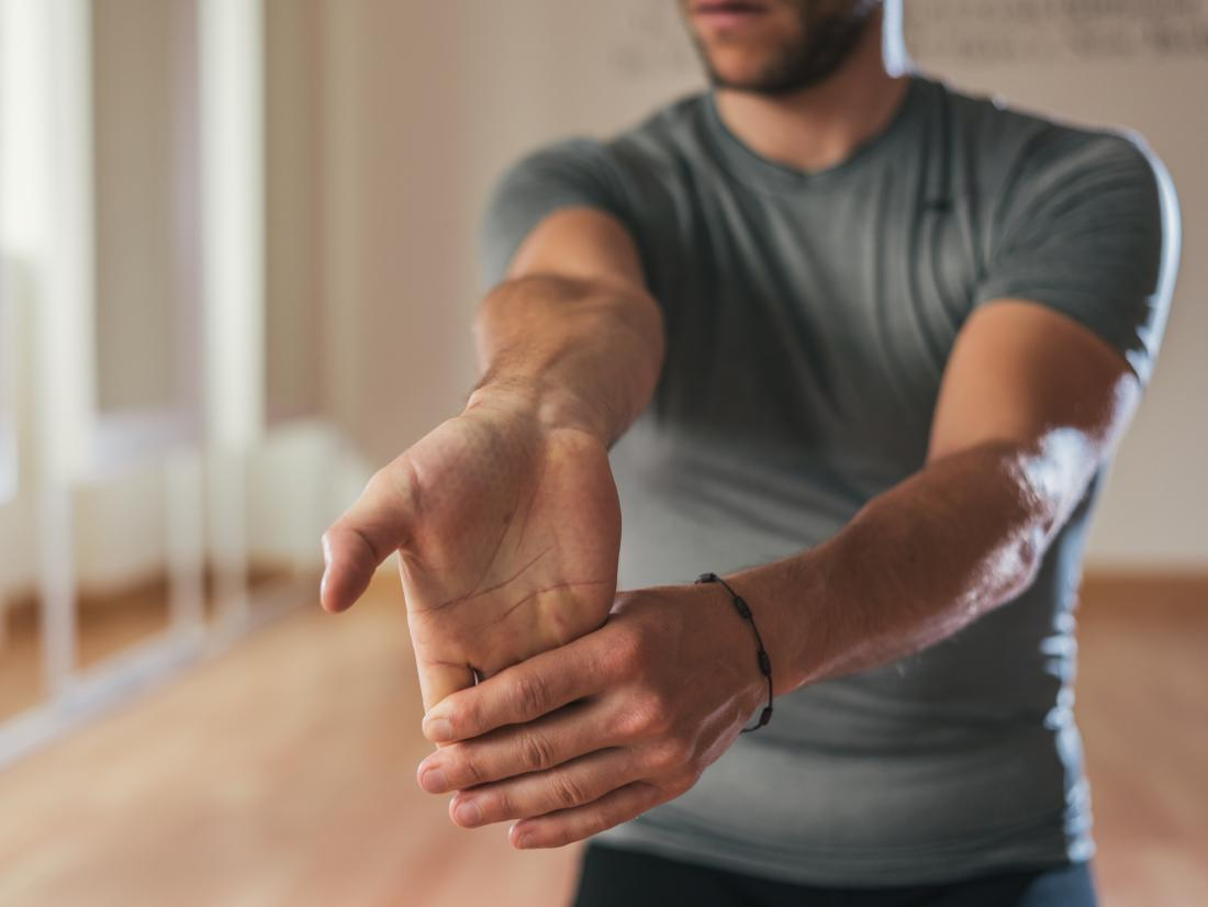 Stretching the wrists and arms can help to prevent swelling.