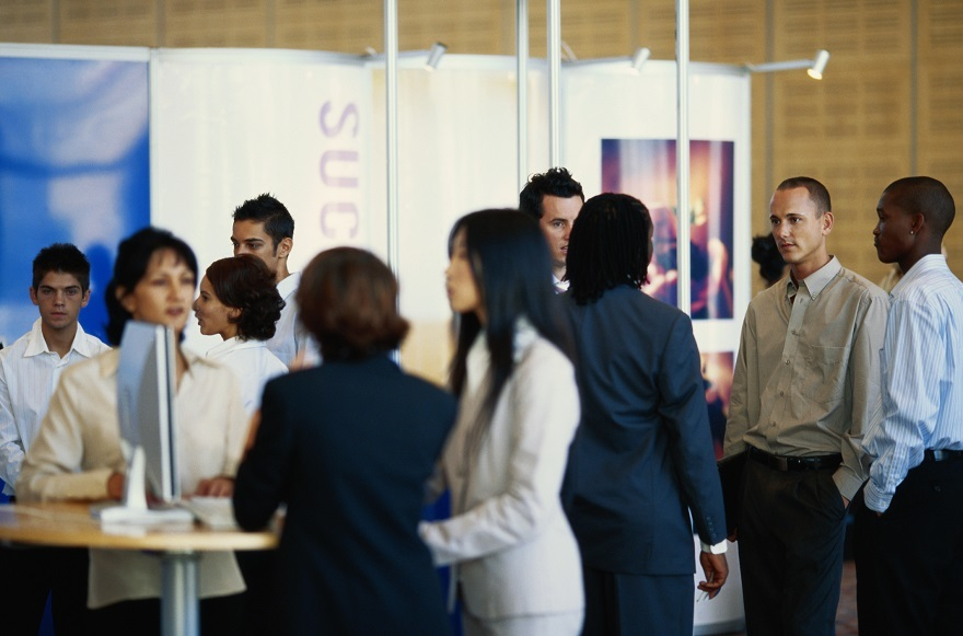 Business Executives in Exhibition Hall